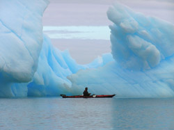 paddling between icebrgs