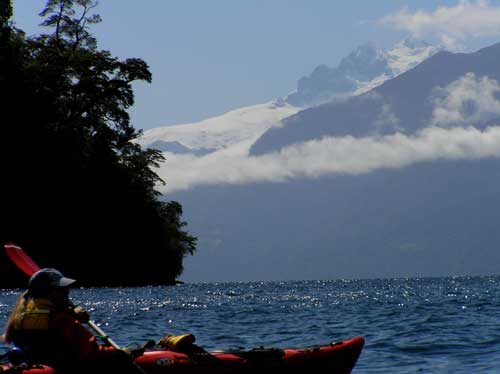 seakayaking Todos los Santos Lake facing Tronador Mount.